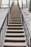 Suddenly there was a big snowfall. Snow covered the stairs stock photo