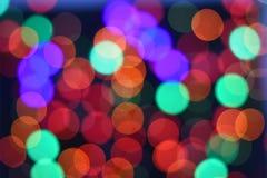 Suddig abstrakt bakgrund för färgrik stjärnabokeh Jul och partibegrepp för nytt år arkivbild