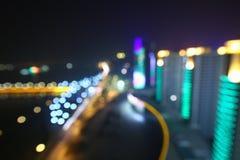 Suddig abstrakt bakgrund tänder, den härliga cityscapesikten Royaltyfri Foto