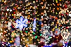 Suddig bakgrund för julljus Arkivfoto