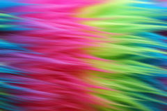 Suddig bakgrund för neonfauxpäls Arkivfoton