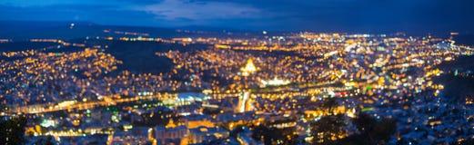 Suddig Bokeh arkitektonisk stads- panorama- bakgrundpanorama Arkivfoto
