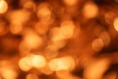 Suddig guld- bakgrund, abstrakt bakgrund av guld- ljus Fotografering för Bildbyråer