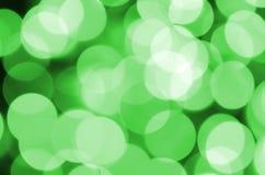 Suddig lysande bakgrund för grön abstrakt jul Defocused konstnärlig bokehljusbild Arkivbilder