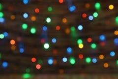 Suddig sikt av julljus festlig bakgrund arkivfoton