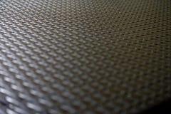 Suddig svart hudyttersida av en plast- dinning tabell för bakgrundstextur royaltyfria bilder