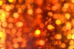 Suddiga orange ljus som bakgrund royaltyfria foton
