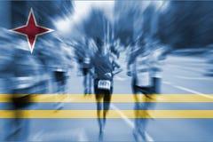 Suddighet för rörelse för maratonlöpare med att blanda den Aruba flaggan Royaltyfria Bilder
