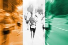 Suddighet för rörelse för maratonlöpare med att blanda den `-Ivoire för skjul D flaggan Royaltyfria Bilder