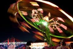 Suddighet rörelse av karnevalritten på natten royaltyfri fotografi