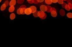 Suddigt, Bokeh, Defocused ljus för röd färg i mörkret, för abstrakt bakgrund med fritt utrymme för design och text Royaltyfri Fotografi