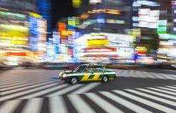 Suddigt för rörelse på korsningen, Shibuya, Tokyo, Japan Royaltyfri Bild