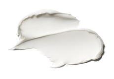 Suddmålarfärg av vita kosmetiska produkter Fotografering för Bildbyråer