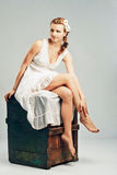 Sudio portrait of a beautiful woman in white stock photo