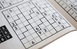 Sudoku кроссворда - популярная игра головоломки Стоковое фото RF