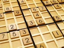 Sudoku. Wood sudoku board and tiles Royalty Free Stock Images