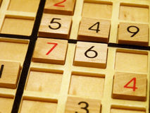 Sudoku. Wood sudoku board and tiles Stock Images
