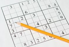 Sudoku. Puzzle and yellow pencil Stock Photography