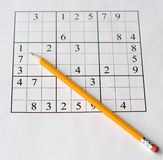 Sudoku. Puzzle and yellow pencil Stock Photos
