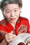 Sudoku del gioco dell'anziana Fotografia Stock