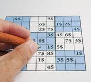 Sudoku with dollars Stock Photo