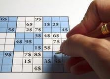 Sudoku with dollars Stock Photos