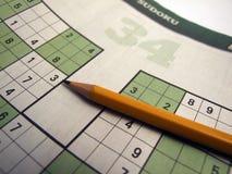 Sudoku en gros plan avec le stylo Image stock