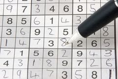 Sudoku grid. With answers and pen Royalty Free Stock Image