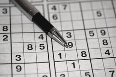 Sudoku. Japanese Sudoku game and ballpoint pen stock image