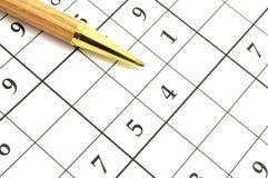 Sudoku lek Arkivfoton