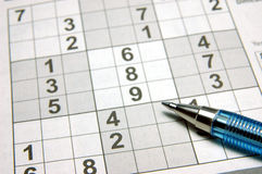 Sudoku puzzle & pen Stock Images