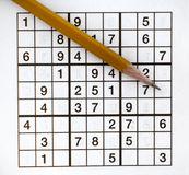 Sudoku Puzzler. Sudoku Puzzle grid and sharpened pencil Royalty Free Stock Photos