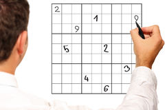 Sudoku solving Royalty Free Stock Photography