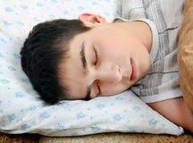 Sueño cansado del adolescente Fotos de archivo libres de regalías