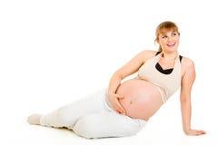 Sueño de la mujer embarazada que se sienta en suelo Fotos de archivo