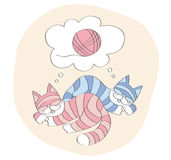 Sueño de los gatos sobre juego con una bola Imagen de archivo
