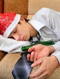 Sueño del adolescente con una cerveza Foto de archivo