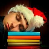 Sueño del estudiante en libros Imágenes de archivo libres de regalías