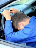 Sueño del hombre en un coche Foto de archivo libre de regalías