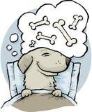 Sueño del hueso de perro Fotografía de archivo libre de regalías