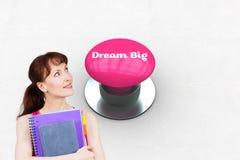 Sueño grande contra el botón rosado foto de archivo