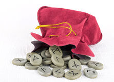 Suede bag of rune stones Royalty Free Stock Image