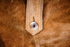 Suede and button Royalty Free Stock Image
