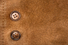 Suede and buttons Stock Photos