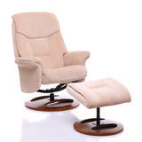 Suede fabric recliner chair with footstool Stock Image