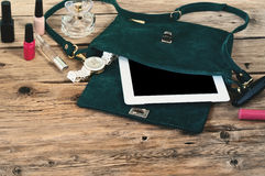 Suede female bag with tablet computer, watch and women cosmetics Stock Image