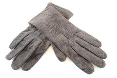 Suede gloves. A pair of brown suede gloves isolated on white background royalty free stock photo