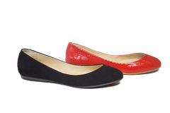 Suede and leather ballet flats. On a white background Royalty Free Stock Image