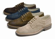 Suede men's shoes of different colors Royalty Free Stock Images