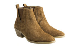 Suede. Pair of brown suede women boots on white Royalty Free Stock Photo
